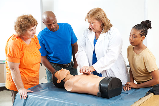 doctor demonstrating CPR on dummy